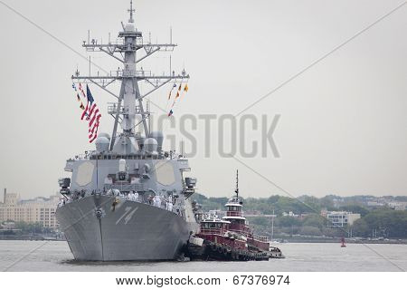 STATEN ISLAND, NY - MAY 21, 2014: The guided-missile destroyer USS McFaul (DDG 074) is guided into port at Sullivans Piers on May 21, 2014. The ship is part of Fleet Week NY.