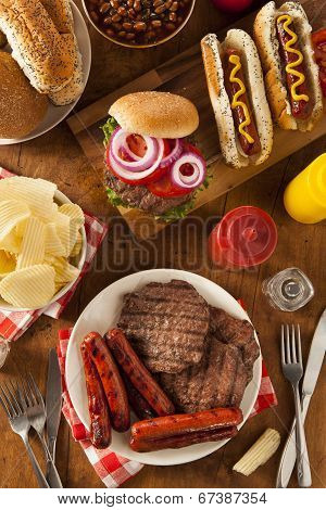 Grilled Hamburgers And Hot Dogs