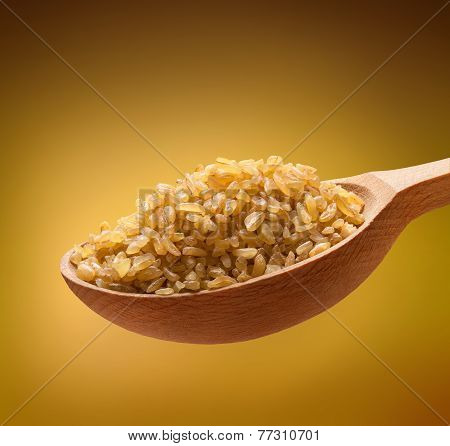 Bulgur in a wooden spoon