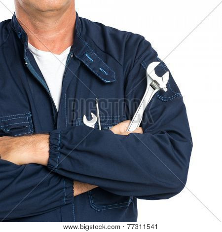 Closeup Of A Mechanic With Arm Crossed Holding Spanner Isolated On White Background poster