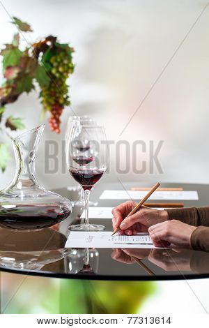 Hand Writing On Paper At Wine Tasting.