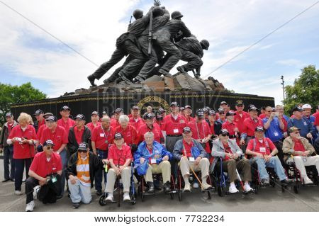 Veterans at a monument.
