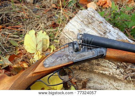 A Wooden Retro Shotgun In Autumn