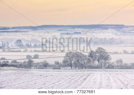 Winter Mist Over Snow-covered Fields