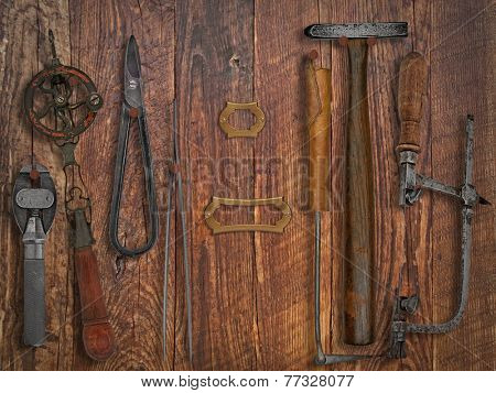 vintage jeweler tools  over wooden working wall, space for text and name