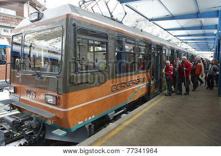 Unidentified skiers embark Gornergrat train at Zermatt station.