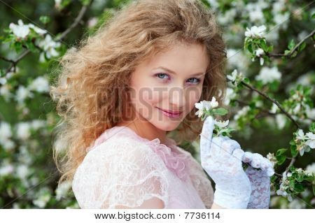 Beautiful Young Woman In White Gloves With Flowers