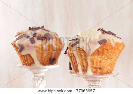 Delicious muffins with chocolate decoration. Toned image.