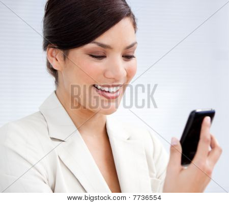 Charming Businesswoman Using A Mobile Phone