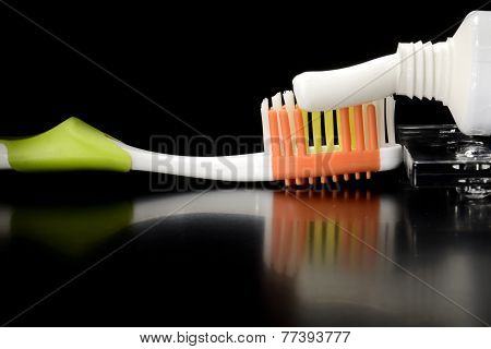 Toothbrush And Toothpaste On Table