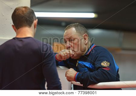NOVOSIBIRSK, RUSSIA - NOVEMBER 26, 2014: Coach Valery Motkin and European champion Armen Zakaryan on the open training during AIBA Pro Boxing tournament. The winners will go to the Olympics-2016