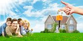 Happy family near new home. Mortgage concept. poster