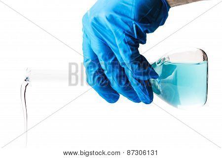 Laboratorian Reagent Pouring