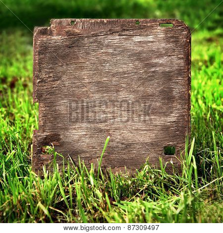 Wooden Board On The Grass