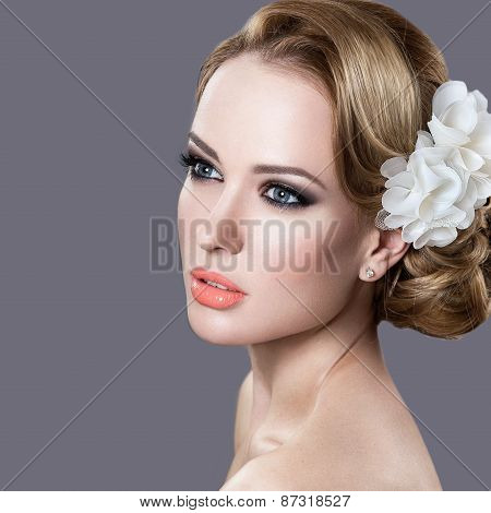 Portrait of a beautiful woman in the image of the bride with flowers in her hair. Beauty face