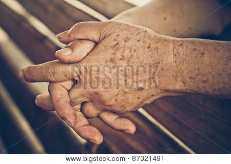 hands of a female elderly in vintage tone