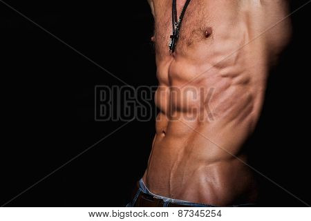 Muscular and sexy torso of young sporty man with perfect abs poster