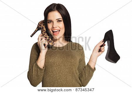 Woman Holding A Shoe Next To Her Ear  Pretending To Talk