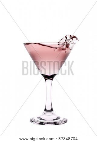 Red liquid splashing in a martini glass isolated on white background