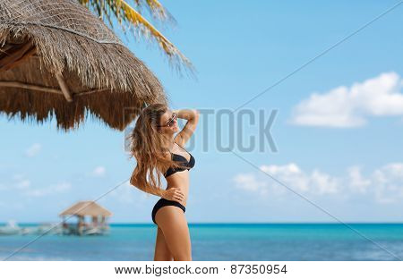 Beach portrait of a beautiful woman with a perfect figure.