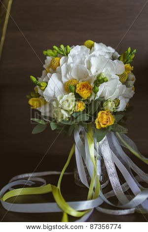 Beautiful wedding bouquet of roses, Craspedia, Hydrangea, Brunia silver flowers