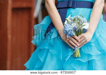 Beautiful wedding bouquet of hydrangea, calla and muscari flowers in hands of the bride
