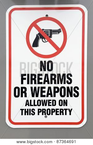 No firearms or weapons warning sign