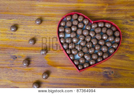 Heart Shaped Box Filled With Small Chocolates Balls