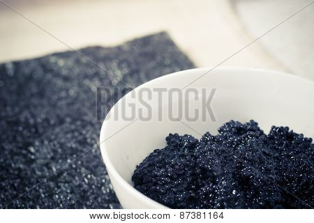 Fresh black caviar in a bowl to make sushi and fish dishes
