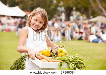 Girl With Fresh Produce Bought At Outdoor Farmers Market