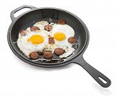 Turkish sausage with egg called sucuklu yumurta on iron cast pan isolated on white background. poster