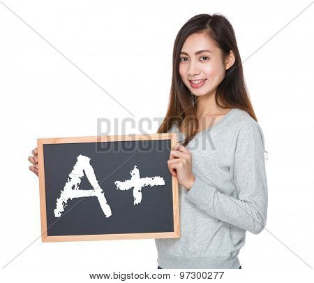 Pretty woman hold with blackboard and showing mark A plus