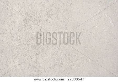 Cream color distressed vintage grungy roughcast or stucco wall for background texture or copy space in horizontal format in Mallorca Balearic islands Spain. poster