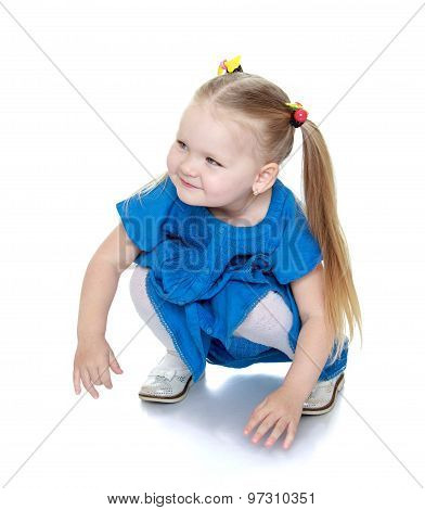 Charming girl sits on the floor