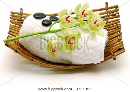 Flower And  Massage Stone On Towel Isolated