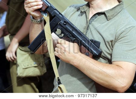 Soldier With A Submachine Gun In His Hand In Training Camp For New Recruits