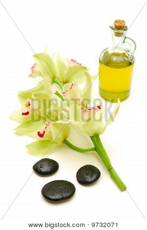 Massage Oil And Stones With Orchids