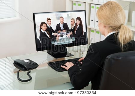 Businesswoman Video Conferencing With Colleagues On Computer