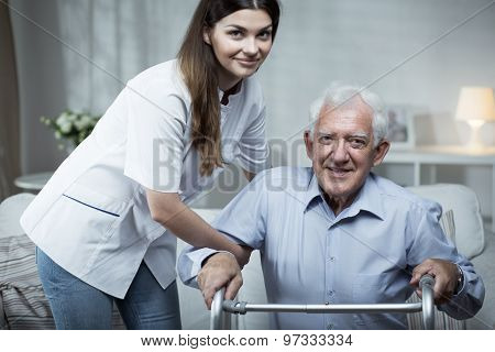Nurse Helping Disabled Senior Man