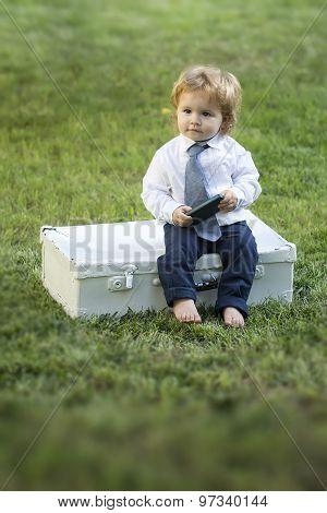 Cute Baby Boy With Vintage Briefcase