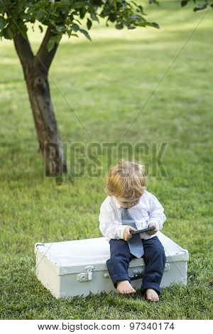 Little Baby Boy With Vintage Briefcase