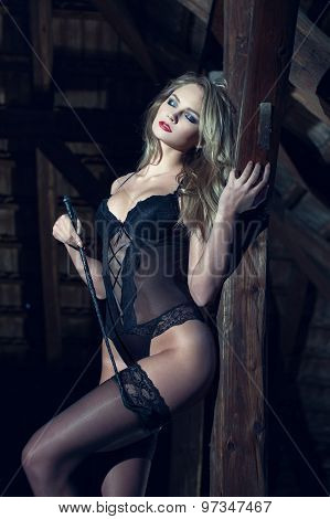 Sensual Woman With Leather Whip Posing At Timber