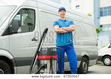 Cleaner Standing With Vacuum Cleaner