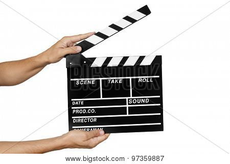closeup of a young man about to clap a traditional wooden clapperboard against a white background