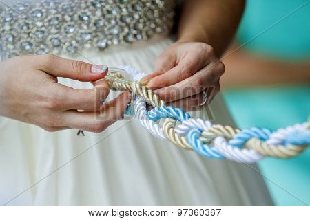 Close up of a Wedding tradition tighting the knot