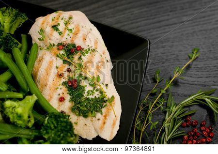 Delicious portion of chicken breast with steamed vegetables