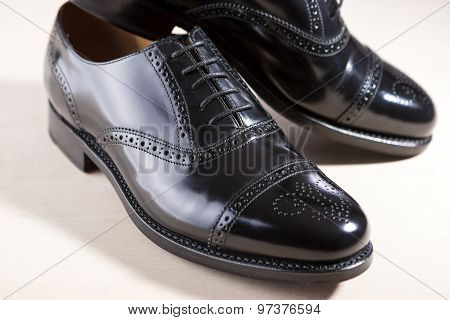 Footwear Concept. Pair Of Black Fashionable Male Oxfords Semi-brouge Laced Shoes.