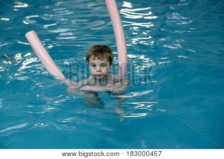 Boy Using Pool Noodles