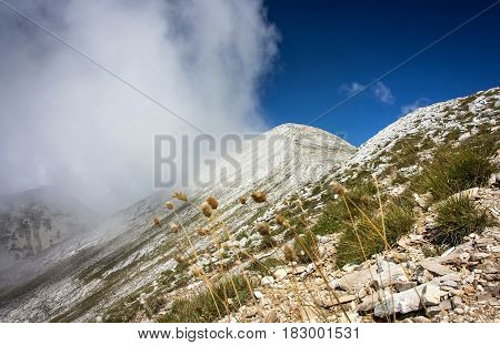 High mountain ridge covered in white  clouds