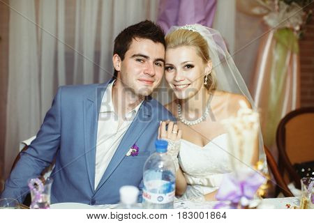 Charming young newlyweds on their wedding party